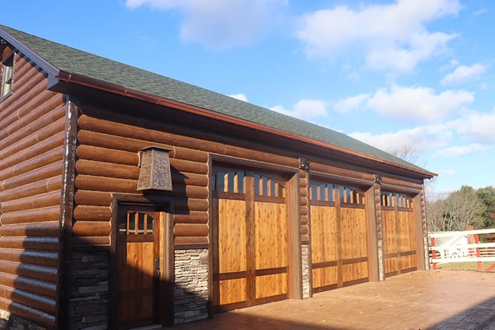 brown gutters on a garage with a log cabin look
